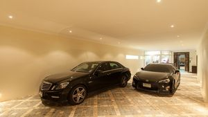 The generous remote controlled garage offers space for 6 cars