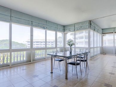 The huge covered terrace space - framed with screens