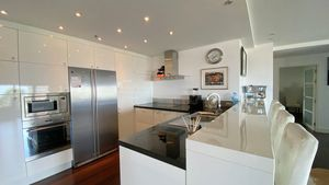 The kitchen is large and top equipped