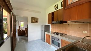 The kitchen is spacious and in a separate room