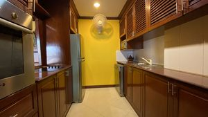 The kitchen offers plenty of storage and is well-equipped