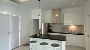 The kitchen with island and breakfast counter
