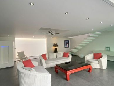 The lounge area behind the pool