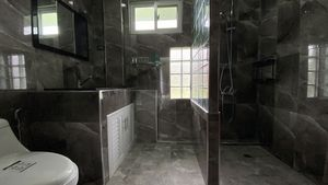 The master-bath is made of grey marble