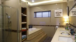 The master-bathroom comes with a Jacuzzi tub
