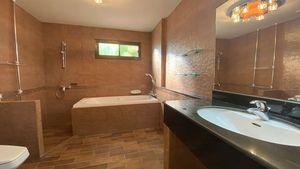 The master-bathroom has a bathtub