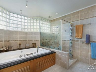 The master-bathroom with a Jacuzzi tub
