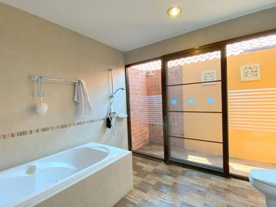The master-bathroom with additional outdoor shower