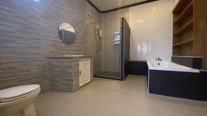 The master-bathroom with tub and shower-cubicle