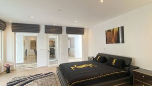 The master-bedroom enjoys views across the pool
