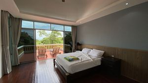 The master-bedroom with walk-in closet and sea views
