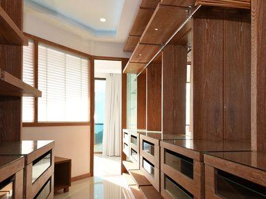 The master-bedrooms walk-in-wardrobe