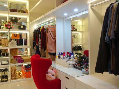 The master-bedrooms walk-in wardrobe