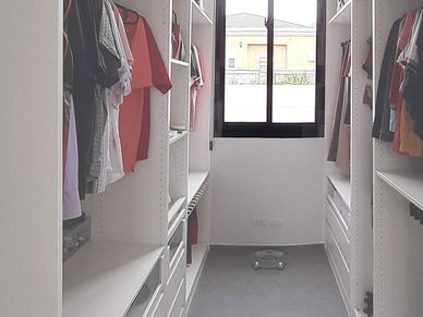 The master-beds walk-in closet