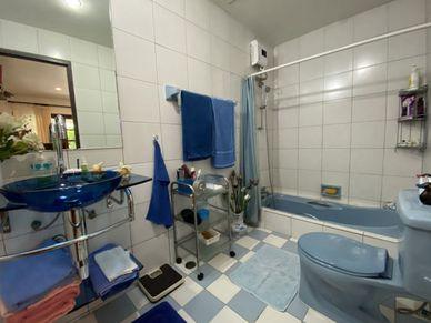 The master bathroom has a bath-tub