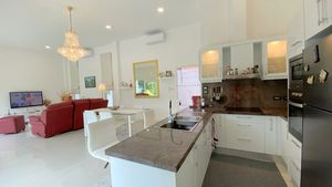 The modern kitchen with breakfast bar counter