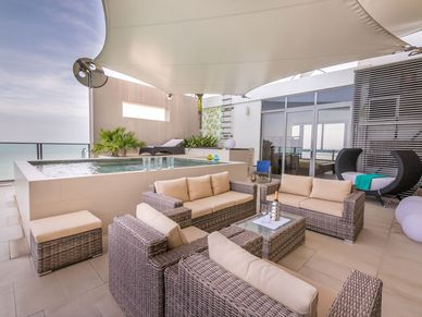 The outdoor lounge area with private pool
