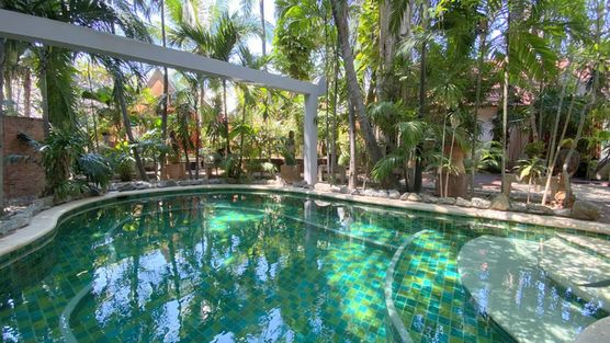 The pool amidst tropical gardens