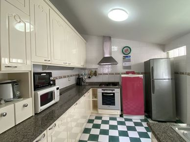 The spacious kitchen is in an extra room