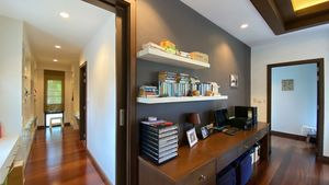 The walk-in closet and office space in the master-bedroom suite