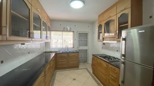 The well-equipped kitchen is in a separate room