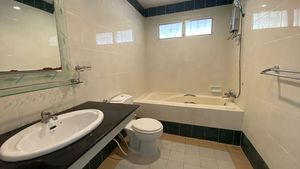 There are 2 bathrooms, this one with a bathtub