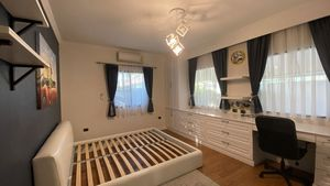 This bedroom offers nice built-in office facilities
