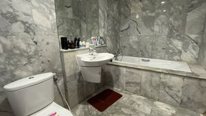 This chic bathroom has a tub and a shower area