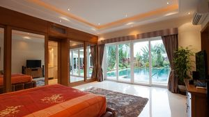 View from a bedroom towards the pool and garden area