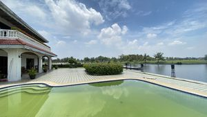 Views across the pool, the villa and the waterway