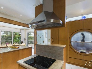 WIth a hatch to the dining-room and views to the outdoors - the kitchen