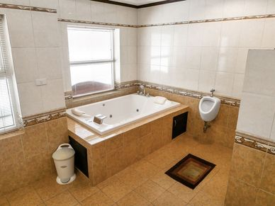 With bathtub and urinal - 1 of 5 bathrooms