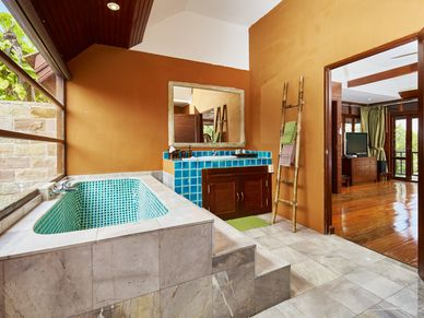 Bathroom with tub and outdoor shower