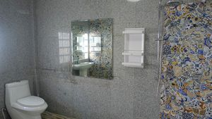 One of three bathrooms