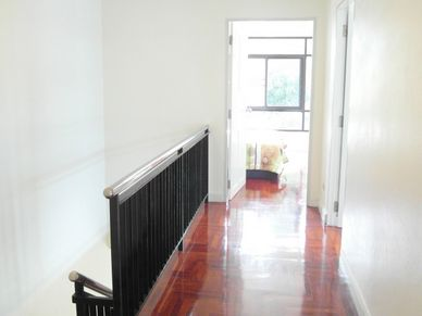 Staircase and upper corridor of this 3-bedroom home at Jomtien Yacht Club