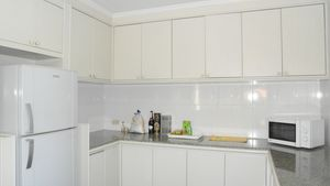 The beautiful kitchen of this 3-bedroom home at Jomtien Yacht Club