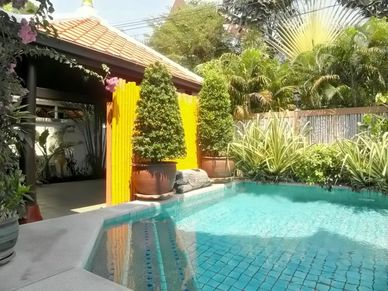 The carport area at this charming Thai Bali inner city pool-villa Jomtien