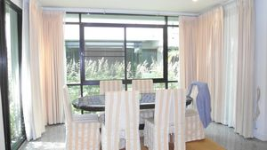 The dining area of this 3-bedroom home at Jomtien Yacht Club