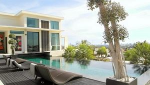 View over pool to master bedroom of this high end residence above Pattaya